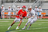Baldwinsville Bees Austin Bolton (15) with the ball against Liverpool Warriors Eric Baker (28) in Section III Boys Lacrosse action at Liverpool High School Stadium in Liverpool, New York on Thursday, May 2, 2019.  Baldwinsville won 12-8.