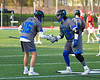 Cicero-North Syracuse Northstars Joe Flood (33) greets Chase Casler (16) during player introductions before a Section III Boys Lacrosse game against the Baldwinsville Bees at Michael Bragman Stadium in Cicero, New York on Tuesday, May 7, 2019.