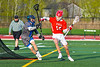 Baldwinsville Bees Spencer Wirtheim (10) is checked by Cicero-North Syracuse Northstars Nolan Firth (13) in Section III Boys Lacrosse action at Michael Bragman Stadium in Cicero, New York on Tuesday, May 7, 2019. Baldwinsville won 21-5.