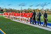 Baldwinsville Bees players and coaches stand for the National Anthem before a  Section III Boys Lacrosse game against the Cicero-North Syracuse Northstars at Michael Bragman Stadium in Cicero, New York on Tuesday, May 7, 2019.