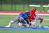 Baldwinsville Bees Jake Walsh (4) facing off against Cicero-North Syracuse Northstars Joel Firth (14) to start a Section III Boys Lacrosse game at Michael Bragman Stadium in Cicero, New York on Tuesday, May 7, 2019. Baldwinsville won 21-5.