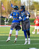 Cicero-North Syracuse Northstars Joe Flood (33) greets Justin Griffith (23) during player introductions before a Section III Boys Lacrosse game against the Baldwinsville Bees at Michael Bragman Stadium in Cicero, New York on Tuesday, May 7, 2019.