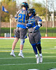 Cicero-North Syracuse Northstars Joe Flood (33) greets Josh Pickard (21) during player introductions before a Section III Boys Lacrosse game against the Baldwinsville Bees at Michael Bragman Stadium in Cicero, New York on Tuesday, May 7, 2019.