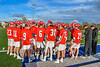 Baldwinsville Bees players huddle up with their coaches before playing the Cicero-North Syracuse Northstars in a Section III Boys Lacrosse game at Michael Bragman Stadium in Cicero, New York on Tuesday, May 7, 2019.