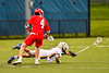 West Genesee Wildcats Max Rosa (13) lunges out to get the ball against Baldwinsville Bees Jake Walsh (4) in Section III Boys Lacrosse action at Mike Messere Field in Camillus, New York on Thursday, May 9, 2019. Baldwinsville won 14-10.
