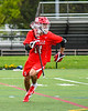 Baldwinsville Bees Quinn Peters (11) running with the ball against the West Genesee Wildcats in Section III Boys Lacrosse action at Mike Messere Field in Camillus, New York on Thursday, May 9, 2019. Baldwinsville won 14-10.