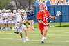Baldwinsville Bees Michael Tangredi (26) with the ball against West Genesee Wildcats Billy Fisher (8) in Section III Boys Lacrosse action at Mike Messere Field in Camillus, New York on Thursday, May 9, 2019. Baldwinsville won 14-10.