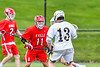 Baldwinsville Bees Quinn Peters (11) defending against West Genesee Wildcats Max Rosa (13) in Section III Boys Lacrosse action at Mike Messere Field in Camillus, New York on Thursday, May 9, 2019. Baldwinsville won 14-10.