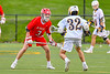 Baldwinsville Bees Adam Davis (3) defending against West Genesee Wildcats Nick Louise (32) in Section III Boys Lacrosse action at Mike Messere Field in Camillus, New York on Thursday, May 9, 2019. Baldwinsville won 14-10.