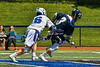 Homer Trojans John Denkenberger (3) wins the face-off against Westhill Warriors Ryan Durand (6) in a Section III Class C Boys Lacrosse playoff game in Syracuse, New York on Saturday, May 18, 2019. Westhill won 14-4.