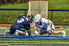 Westhill Warriors Ryan Durand (6) and Homer Trojans John Denkenberger (3) facing off in a Section III Class C Boys Lacrosse playoff game in Syracuse, New York on Saturday, May 18, 2019. Westhill won 14-4.