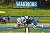 Westhill Warriors Ryan Durand (6) and Homer Trojans John Denkenberger (3) face-off to start a Section III Class C Boys Lacrosse playoff game in Syracuse, New York on Saturday, May 18, 2019. Westhill won 14-4.