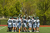 Marcellus Mustangs huddle up before playing the Jordan-Elbridge Eagles in a Section III Class D Boys Lacrosse playoff game in Marcellus, New York on Saturday, May 18, 2019.