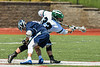 Marcellus Mustangs Mike Kaczor (33) wins a face-off with Jordan-Elbridge Eagles Luke Pinckney (16) in Section III Class D Boys Lacrosse playoff action in Marcellus, New York on Saturday, May 18, 2019. Marcellus won 20-5.