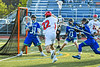 Baldwinsville Bees Brendan Wilcox (22) drives to the net with the ball against Cicero-North Syracuse Northstars goalie Joe Bartolo (31) in Section III Class A Semifinals Boys Lacrosse action at Michael Bragman Stadium in Cicero, New York on Tuesday, May 21, 2019. Baldwinsville won 7-4.