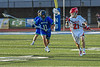Baldwinsville Bees Cameron Sweeney (21) with the ball against Cicero-North Syracuse Northstars Aidan Longley (11) in Section III Class A Semifinals Boys Lacrosse action at Michael Bragman Stadium in Cicero, New York on Tuesday, May 21, 2019. Baldwinsville won 7-4.