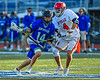 Cicero-North Syracuse Northstars Joel Firth (14) with the ball against Baldwinsville Bees Jake Walsh (4) in Section III Class A Semifinals Boys Lacrosse action at Michael Bragman Stadium in Cicero, New York on Tuesday, May 21, 2019. Baldwinsville won 7-4.