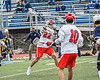 Baldwinsville Bees Brendan Wilcox (22) leans into a shot at the West Genesee Wildcats net in Section III Class A Finals Boys Lacrosse action at Michael Bragman Stadium in Cicero, New York on Friday, May 24, 2019. Baldwinsville won 18-6.