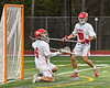 Baldwinsville Bees goalie Cooper Foote (5) makes a save against the West Genesee Wildcats in Section III Boys Lacrosse action at the Pelcher-Arcaro Stadium in Baldwinsville, New York on Tuesday, May 4, 2021. Baldwinsville won 11-4.