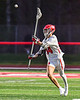Baldwinsville Bees Tucker Macknik (14) passing the ball against the West Genesee Wildcats in Section III Boys Lacrosse action at the Pelcher-Arcaro Stadium in Baldwinsville, New York on Tuesday, May 4, 2021. Baldwinsville won 11-4.