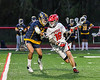 Baldwinsville Bees Lucas Hoskin (16) making a run past a West Genesee Wildcats defender in Section III Boys Lacrosse action at the Pelcher-Arcaro Stadium in Baldwinsville, New York on Tuesday, May 4, 2021. Baldwinsville won 11-4.