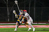 Baldwinsville Bees Tucker Macknik (14) defending against West Genesee Wildcats Alex Rosa (13) in Section III Boys Lacrosse action at the Pelcher-Arcaro Stadium in Baldwinsville, New York on Tuesday, May 4, 2021. Baldwinsville won 11-4.