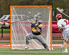 Baldwinsville Bees Ryan Hollenbeck (17) shoots and scores a goal against West Genesee Wildcats goalie Bryce Landry (12) in Section III Boys Lacrosse action at the Pelcher-Arcaro Stadium in Baldwinsville, New York on Tuesday, May 4, 2021. Baldwinsville won 11-4.