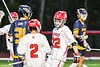 Baldwinsville Bees Carson Dyl (22) celebrates his goal against the West Genesee Wildcats in Section III Boys Lacrosse action at the Pelcher-Arcaro Stadium in Baldwinsville, New York on Tuesday, May 4, 2021. Baldwinsville won 11-4.