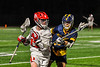 Baldwinsville Bees Keegan Lynch (13) protecting the ball from a West Genesee Wildcats defender in Section III Boys Lacrosse action at the Pelcher-Arcaro Stadium in Baldwinsville, New York on Tuesday, May 4, 2021. Baldwinsville won 11-4.