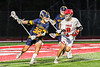 Baldwinsville Bees Jack Parrott (8) defending against West Genesee Wildcats Liam Burns (32) in Section III Boys Lacrosse action at the Pelcher-Arcaro Stadium in Baldwinsville, New York on Tuesday, May 4, 2021. Baldwinsville won 11-4.