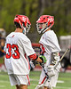 Baldwinsville Bees Colin Socker (26) congratulates Trey Ordway (33) on his goal against the West Genesee Wildcats in Section III Boys Lacrosse action at the Pelcher-Arcaro Stadium in Baldwinsville, New York on Tuesday, May 4, 2021. Baldwinsville won 11-4.