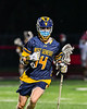 West Genesee Wildcats Joseph DeLany (14) cradling the ball against the Baldwinsville Bees in Section III Boys Lacrosse action at the Pelcher-Arcaro Stadium in Baldwinsville, New York on Tuesday, May 4, 2021. Baldwinsville won 11-4.