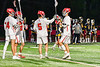 Baldwinsville Bees goalie Cooper Foote (5) celebrating a Bess goal against the West Genesee Wildcats in Section III Boys Lacrosse action at the Pelcher-Arcaro Stadium in Baldwinsville, New York on Tuesday, May 4, 2021. Baldwinsville won 11-4.