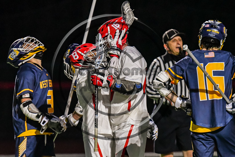 Baldwinsville Bees Lucas Hoskin (16) celebrates his goal against the West Genesee Wildcats in Section III Boys Lacrosse action at the Pelcher-Arcaro Stadium in Baldwinsville, New York on Tuesday, May 4, 2021. Baldwinsville won 11-4.