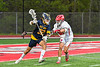 Baldwinsville Bees Jack Prossner (10) defending against West Genesee Wildcats Liam Burns (32) in Section III Boys Lacrosse action at the Pelcher-Arcaro Stadium in Baldwinsville, New York on Tuesday, May 4, 2021. Baldwinsville won 11-4.