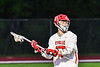 Baldwinsville Bees Ryan Hollenbeck (17) lookiing to make a pass against the West Genesee Wildcats in Section III Boys Lacrosse action at the Pelcher-Arcaro Stadium in Baldwinsville, New York on Tuesday, May 4, 2021. Baldwinsville won 11-4.