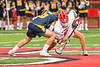 Baldwinsville Bees Jacob Czyz (7) wins a face-off against West Genesee Wildcats Ethan Tait (6) in Section III Boys Lacrosse action at the Pelcher-Arcaro Stadium in Baldwinsville, New York on Tuesday, May 4, 2021. Baldwinsville won 11-4.