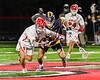 Baldwinsville Bees Jacob Czyz (7) going after the ball against West Genesee Wildcats Nicholas Louise (5) in Section III Boys Lacrosse action at the Pelcher-Arcaro Stadium in Baldwinsville, New York on Tuesday, May 4, 2021. Baldwinsville won 11-4.