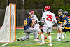 Baldwinsville Bees Brayden Penafeather-Stevenson (21) shoots and scores on West Genesee Wildcats goalie Bryce Landry (12) in Section III Boys Lacrosse action at the Pelcher-Arcaro Stadium in Baldwinsville, New York on Tuesday, May 4, 2021. Baldwinsville won 11-4.