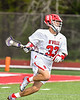 Baldwinsville Bees Trey Ordway (33) running with the ball against the West Genesee Wildcats in Section III Boys Lacrosse action at the Pelcher-Arcaro Stadium in Baldwinsville, New York on Tuesday, May 4, 2021. Baldwinsville won 11-4.