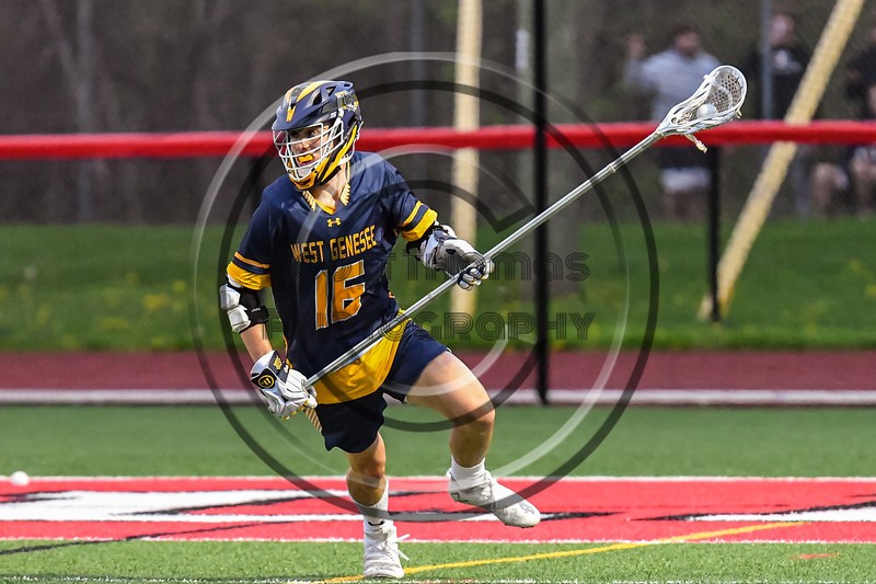 West Genesee Wildcats Jack Garvey (16) with the ball against the Baldwinsville Bees in Section III Boys Lacrosse action at the Pelcher-Arcaro Stadium in Baldwinsville, New York on Tuesday, May 4, 2021. Baldwinsville won 11-4.