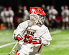 Baldwinsville Bees Keegan Lynch (13) with the ball against the West Genesee Wildcats in Section III Boys Lacrosse action at the Pelcher-Arcaro Stadium in Baldwinsville, New York on Tuesday, May 4, 2021. Baldwinsville won 11-4.