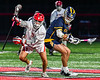 Baldwinsville Bees Jacob Czyz (7) wins a face-off against West Genesee Wildcats Nicholas Louise (5) in Section III Boys Lacrosse action at the Pelcher-Arcaro Stadium in Baldwinsville, New York on Tuesday, May 4, 2021. Baldwinsville won 11-4.