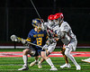 Baldwinsville Bees defenders John Morrissey (18) and Tucker Macknik (14) stop West Genesee Wildcats Alex Rosa (13) from advancing on the Baldwinsville net in Section III Boys Lacrosse action at the Pelcher-Arcaro Stadium in Baldwinsville, New York on Tuesday, May 4, 2021. Baldwinsville won 11-4.