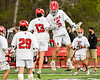 Baldwinsville Bees Keegan Lynch (13) and goalie Cooper Foote (5) during introductions before playing the West Genesee Wildcats in a Section III Boys Lacrosse game at the Pelcher-Arcaro Stadium in Baldwinsville, New York on Tuesday, May 4, 2021.