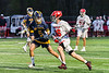 West Genesee Wildcats Nicholas Louise (5) defending against Baldwinsville Bees Lucas Hoskin (16) in Section III Boys Lacrosse action at the Pelcher-Arcaro Stadium in Baldwinsville, New York on Tuesday, May 4, 2021. Baldwinsville won 11-4.