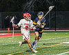 Baldwinsville Bees Victor Ianno (2) with the ball against the West Genesee Wildcats in Section III Boys Lacrosse action at the Pelcher-Arcaro Stadium in Baldwinsville, New York on Tuesday, May 4, 2021. Baldwinsville won 11-4.
