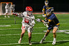 Baldwinsville Bees Keegan Lynch (13) cradling the ball against a West Genesee Wildcats defender in Section III Boys Lacrosse action at the Pelcher-Arcaro Stadium in Baldwinsville, New York on Tuesday, May 4, 2021. Baldwinsville won 11-4.