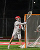 Baldwinsville Bees goalie Cooper Foote (5) passing the ball against the West Genesee Wildcats in Section III Boys Lacrosse action at the Pelcher-Arcaro Stadium in Baldwinsville, New York on Tuesday, May 4, 2021. Baldwinsville won 11-4.