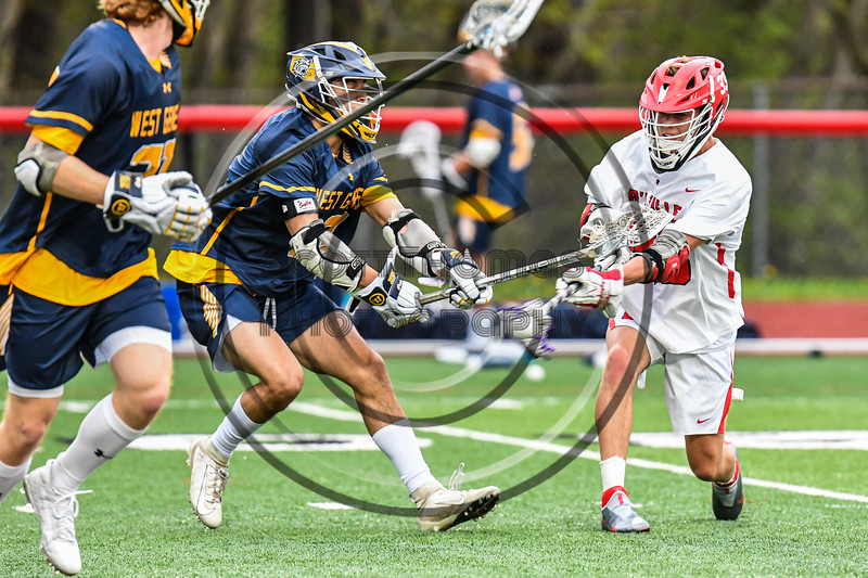 Baldwinsville Bees Tray Ordway (33) shoots and scores against the West Genesee Wildcats in Section III Boys Lacrosse action at the Pelcher-Arcaro Stadium in Baldwinsville, New York on Tuesday, May 4, 2021. Baldwinsville won 11-4.